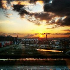 Morning @ndsm #amsterdam #iamsterdam #ndsm #nederland #netherlands #sunrise #beautiful #clouds #industry #zon #sun #sonne #geel #yellow #water #parking #hotel #blue #blauw #blau #orange #oranje #reflection