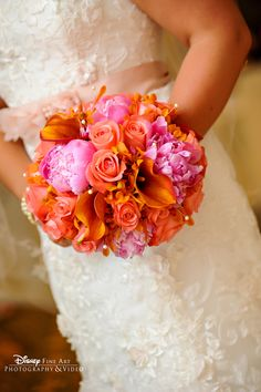 Bright pink and orange mixed floral bouquet that really pops against a crisp white dress #pink #orange #wedding #bouquet