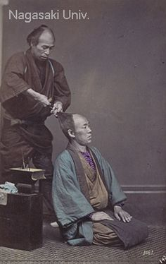 "Japan, circa 1880s. Barber giving the popular ""sakayaki"" haircut -- the face & head were shaved in a half-circle from forehead to crown, and the remaining hair arranged in a topknot.  Photographer Usui Shuzaburo"