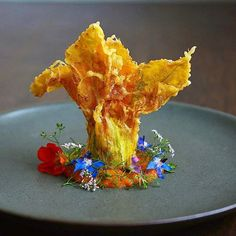 """By @cookingwithmamamui """"Stuffed zucchini blossom with red bell pepper coulis..."""" #foodphotography #f52grams #food #foodporn #gourmet #instagramfood #chef #foodart #lovefood #artofplating #instafood #yummy #foodpic #photooftheday #instagourmet #dinner #foodvsco #dessert #delicious #taste #foodartchefs #eat #gastronomy #love #foodie #cook #cooking #foodgasm #culinaryart"""
