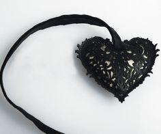 """Pendente """"Ex voto negro"""" realizzato in pelle nera spessore 250 micron tagliata a laser con interno imbottito in stoffa, Ispirati all'opera e al mood di Frida Khalo, collana in filo di organza"""