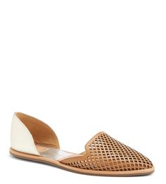 Pairing these adorable, two-toned perforated flats with a white tee tucked into a denim midi-skirt.
