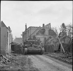 The march on Berlin: A Cromwell tank of the British 7th Armored Division passes a roadblock in the devastated town of Stadtlohn, 31 March 1945.