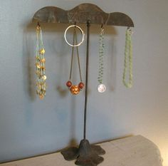 Vintage industrial stand used as jewelry display