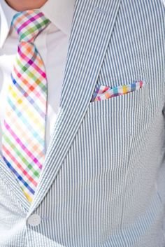 Perfect summer look: seersucker suit with ultra-colorful tie and pocket square over a white shirt....very well done (and cool)....