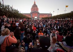 Fans watching the final game of the 2010 world series on live TV in front of civic center San Francisco. SF Giants won 3-1.