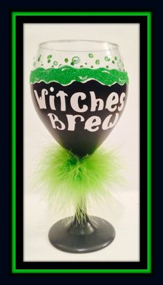 Halloween Hand Painted Wine Glasses! Witches Brew in black and lime green glitter with fur boa. Bubbles of fun! 20 oz glass. $24.00 per glass giftswithglamor@gmail.com