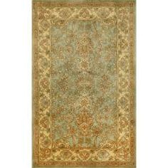 Hand-tufted Issa Blue Wool Rug (8' x 10').  Ordered  this for our Master Bedroom to go over dark cherry stained floors.