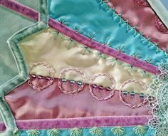 Closeup view of embroidery and beadwork on my crazy-quilted sewing machine cover.