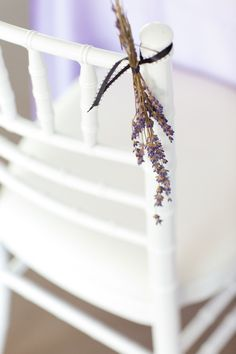 Lavender (+ leaves or something) on chair backs.