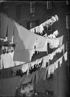 Washing on lines in a New York City courtyard, undated, by Robert L. Bracklow, PR. Scan from glass plate negative. PR 008, New-York Historical Society, 66000-1276.