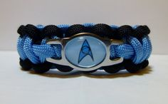 Are you joining the latest starship landing party? If so, you might want to wear a Star Trek Paracord Bracelet.  Look as dashing as Captain Kirk, as suave as Mr. Spock, and as sexy at Lt. Uhura with one of these stylish bracelets that beams fashion into the 23rd century.  Made with 550 Paracord
