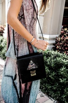 DREAM'S CODE leather bag styled by Miami fashion blogger Tanya Litkovska. More on HIDEMYCOAT blog