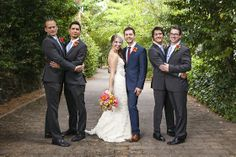 A Bright, Picturesque Wedding in Healdsburg | 7x7 - Caitlin + Trevor. Designed by Lindsey Relyea of l'Relyea Events - Lace bridal gown, bright colorful bouquet, blue groom's suit, grey groomsmen suits