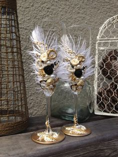 Items similar to Great Gatsby wedding champagne glasses with ostrich feathers in ivory, black and gold, toasting flutes for your wedding reception or a gift on Etsy Great Gatsby Party, Wedding Centerpieces, Wedding Decorations, Masquerade Party Decorations, Masquerade Ball Party, Sweet 16 Masquerade, Masquerade Theme, Harlem Nights Party, Wedding Glasses