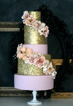 The caketress :) Gold, pink and floral wedding cake. SAY WHAT??!! I want this. though it would only be at my imaginary wedding because i dont even have a boyfriend...