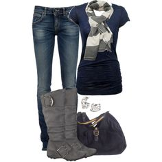 Navy blue tee-shirt, dark blue faded jeans with grey mid calf boots , grey purse and grey and white scarf