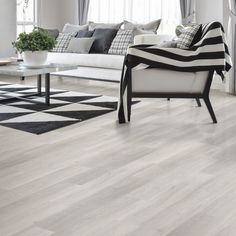 Shop our selection of vinyl plank floors at the Home Depot Canada. We stock luxury vinyl planks from brands like Allure, Lifeproof, Armstrong & more. Grey Vinyl Plank Flooring, Wood Tile Floors, Luxury Vinyl Flooring, Luxury Vinyl Plank, Hardwood Floors, Modern Wood Floors, White Wood Floors, Hardwood Floor Stain Colors, Vinyl Planks