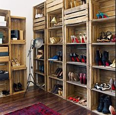 I seriously need a wall like this for all my shoes and boots. I like the crate idea.