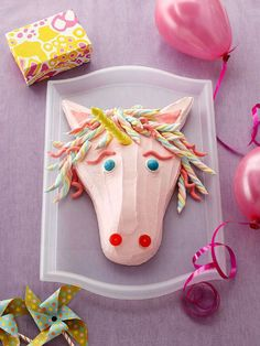 A cleverly cut sheet cake transforms into a birthday unicorn with a flowing mane of marshmallow twists. The horn could even be made from a big candle!