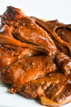 BBQ Pork steaks in the slow cooker or crockpot are SO much easier than grilling, and they come out so tender! These were so easy!