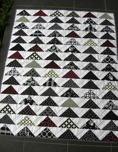 Flying geese front by kimbiafra, via Flickr.  Blogged at stashoverflow.  Quilted in diagonal lines.