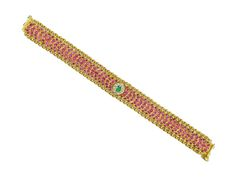 Bracelet studded with burmese rubies and uncut diamonds, with emerald embellishment, from Karni Jewellers.