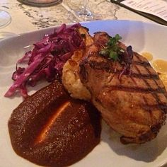 Pork Chop. Really great flavor and moist. Braised cabbage a pleasant ...