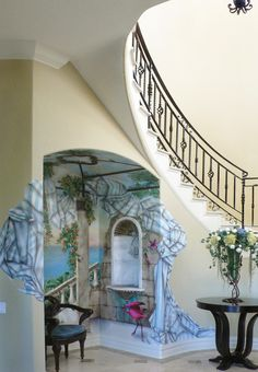 With the talent of artist Zebo Ludvicek's trompe l'oeil, this barrel arch under the staircase becomes a beautiful conversation piece...