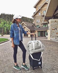 Fall Instagram Round-up | Hello Fashion. Grey tank top+black leggins+olive sneakers+white baseball hat+denim jacket+grey weekender bag+black suitcase. Fall Travel Outfit 2016