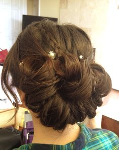 Bridal updo with incorporated braids by Lisa Leming