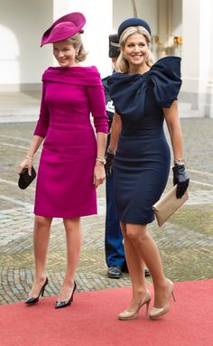 Two beautiful European queens - Mathilde, queen of Belgium in hot pink and Maxima, queen of Netherland in navy blue.