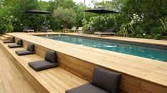 Turn your boring yard into the adorable ones by applying one of the above ground pool with deck ideas that will elevate the house into the fancy ones. Above Ground Pool Landscaping, Above Ground Pool Decks, Backyard Pool Landscaping, Above Ground Swimming Pools, Modern Landscaping, In Ground Pools, Landscaping Ideas, Pergola Ideas, Rectangle Above Ground Pool