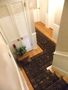 Angled Custom Staircase Area Rug Runner installed with border. https://www.ruggoddess.com/stairway-and-rug-runners.html