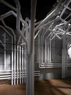 Makoto Tanijiri of Hiroshima architects Suppose Design Office has completed an installation at the Diesel Denim Gallery Aoyama in Tokyo, Japan. Called Nature Factory, the installation uses plastic plumbing pipes and joints to create a series of tree-like forms inside the store. See our earlier story about this project. The installation opened last week and More