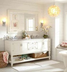 Pottery Barn bathroom - white horizontal paneling, large mirror, sunlight