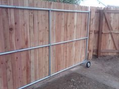 Wood Fence Ideas with a gate | steel framed roll gate with wood finish