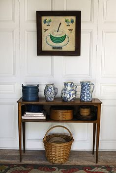 Bunny Mellon's Oak Spring Farm.   A stenciled still life of watermelon, 1839 (top); a group of three earthenware American jugs, nineteenth-century.