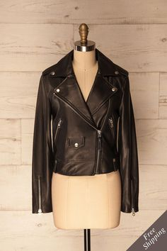 Reznos Licorice #Boutique1861 / This classic leather motorcycle jacket will become a wardrobe staple with its silver hardware and asymmetrical frontal closure. Two zippered pockets are handy for your phone and wallet, while a little pocket with snap closure is the perfect size for your keys or loose change. The thick lambskin leather will surely protect you from any weather in style.