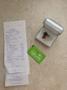 Sugar packet, receipt and sea glass from Costa Rica