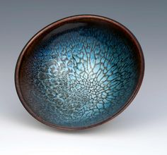 meredithstewartceramics:  Meredith Stewart I have been making Chun on Tenmoku bowls for years, they are my best-selling product, and still present a challenge. This example is the best bowl I have ever produced - it's in the glass cabinet as part of my personal collection