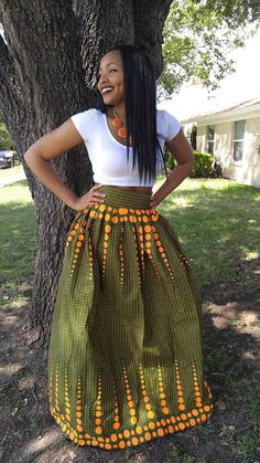Welcome! A million thanks for stopping by OLUDAN. We are here to serve you.  Beautiful 100% African wax ankara green and orange Maxi skirt with a 3 inches high waist, great length and gathers all around. 100% cotton.  This beautiful skirt has a length of 43 inches, a zipper at the back and a waistband for a great fit. Dashiki skirt must be worn on your natural waist (under your bust)  Available in the sizes below. Use your precise waist in inches against these measurements so you order…