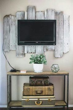 A possible way to dress up the TV if we hang it. If the backer extends downward far enough, the cords can be totally concealed.