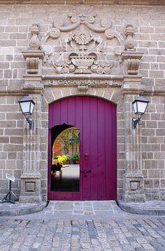 Magnificent purple door and carved stone doorway in Manila. Is the open section… Cool Doors, The Doors, Unique Doors, Windows And Doors, Door Knockers, Door Knobs, Portal, Gazebos, Intramuros
