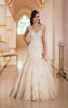 Beautiful plunging backless wedding dress features handcrafted Diamante beading and Lace in your choice of gold, ivory or white. Designer wedding dress by Stella York.