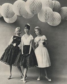 Lois Gunas Wideman (l) in a tiered lace lined with taffeta dress by Doris Dodson, Dolores Hawkins is wearing a satin and Chantilly lace skirt by Mister David and the model on the right has on a dress by JonathanLogan, 1958