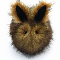 Hi, my name is Rusty and I am a Fuzziggle. I have fluffy brown fur with black tips and my ears are black on the inside. I come in three sizes about 4x6, 5x8, and 6x10 inches, not including my ears and