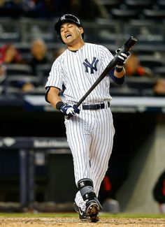 Jacoby Ellsbury #22 of the New York Yankees reacts after flying out during the eighth inning against the Baltimore Orioles at Yankee Stadium...