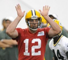 Green Bay Packers quarterback Aaron Rodgers signals a play during minicamp practice in the Don Hutson Center, Wednesday, June 5, 2013. H. Marc Larson/Press-Gazette Media