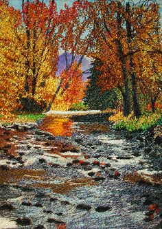 Thread painting of a river in Autumn near Tuxedo, NC. Based on a photo by my friend and photographer, Edgar Woodfin and rendered with his permission.